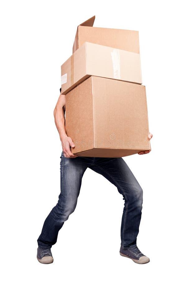 Человек держа тяжелые коробки карточки стоковые изображения