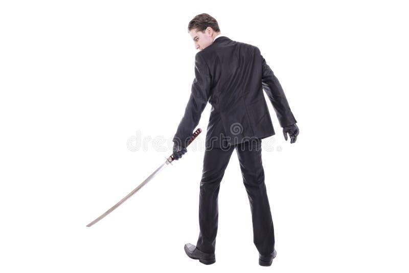 Человек держа katana стоковая фотография