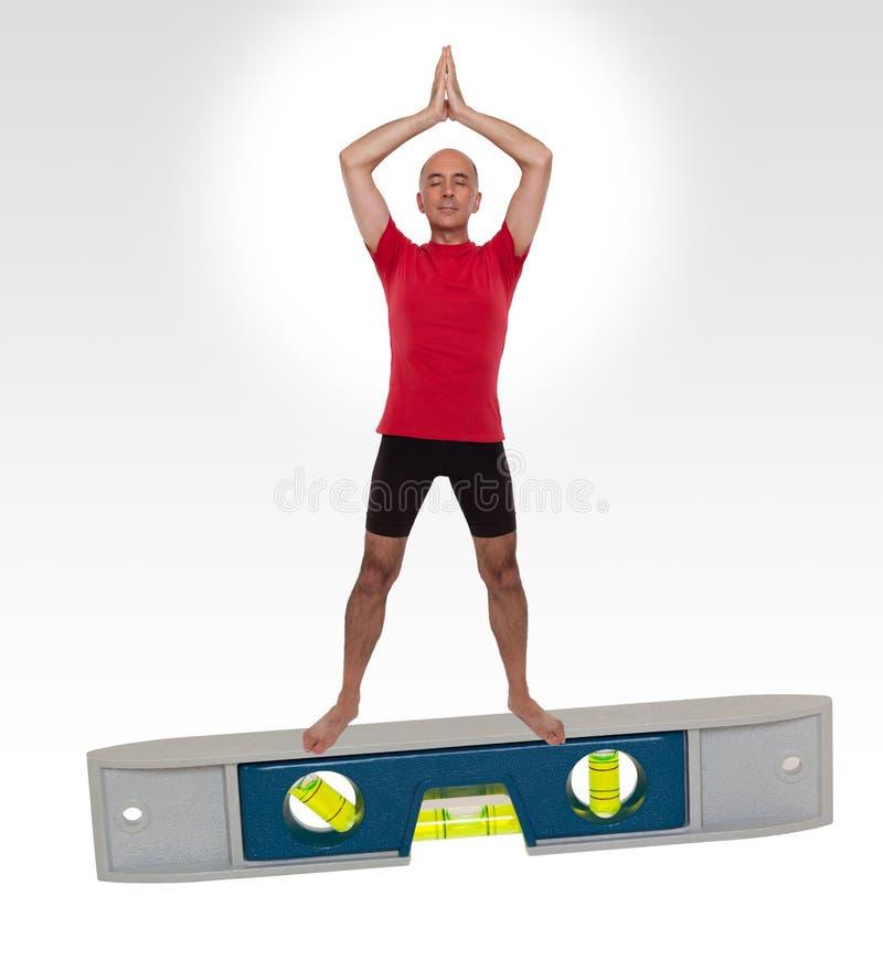 Человек делая положение йоги стоковые изображения rf