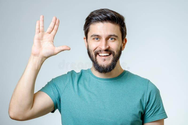 Человек делая Vulcan салютовать стоковая фотография
