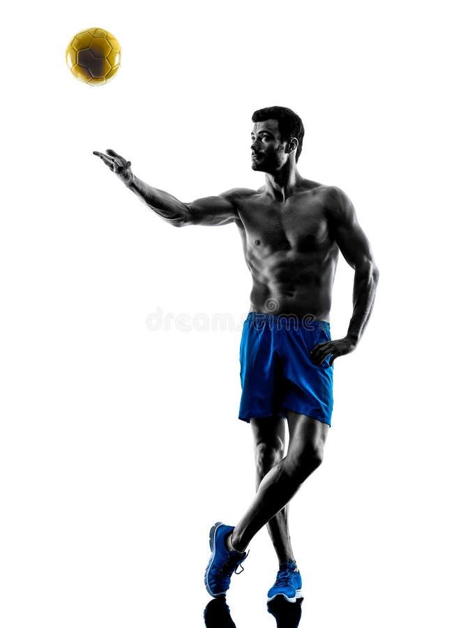 Человек играя силуэт пляжного волейбола стоковое фото rf