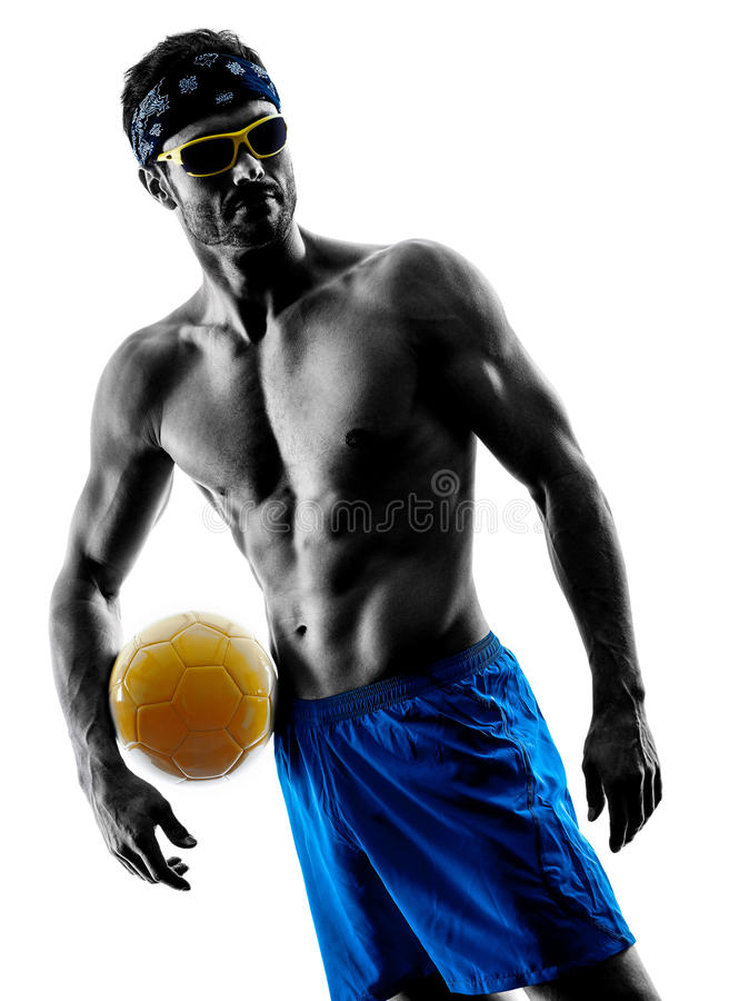 Человек играя силуэт пляжного волейбола стоковая фотография rf