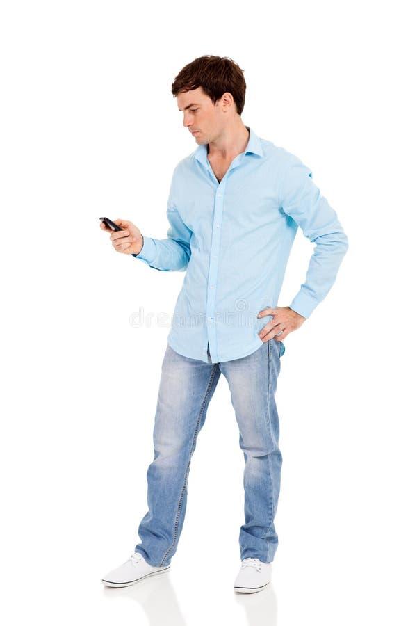 Человек используя умный телефон стоковое фото rf
