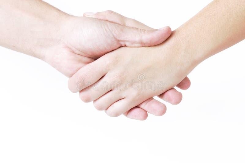 Человек и женщина тряся руки, на белизне Рука женщины в fr стоковое фото