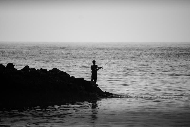 Человек и море стоковые фотографии rf