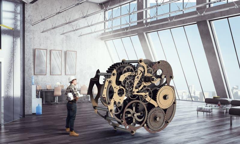 Человек и clockwork построителя Мультимедиа бесплатная иллюстрация