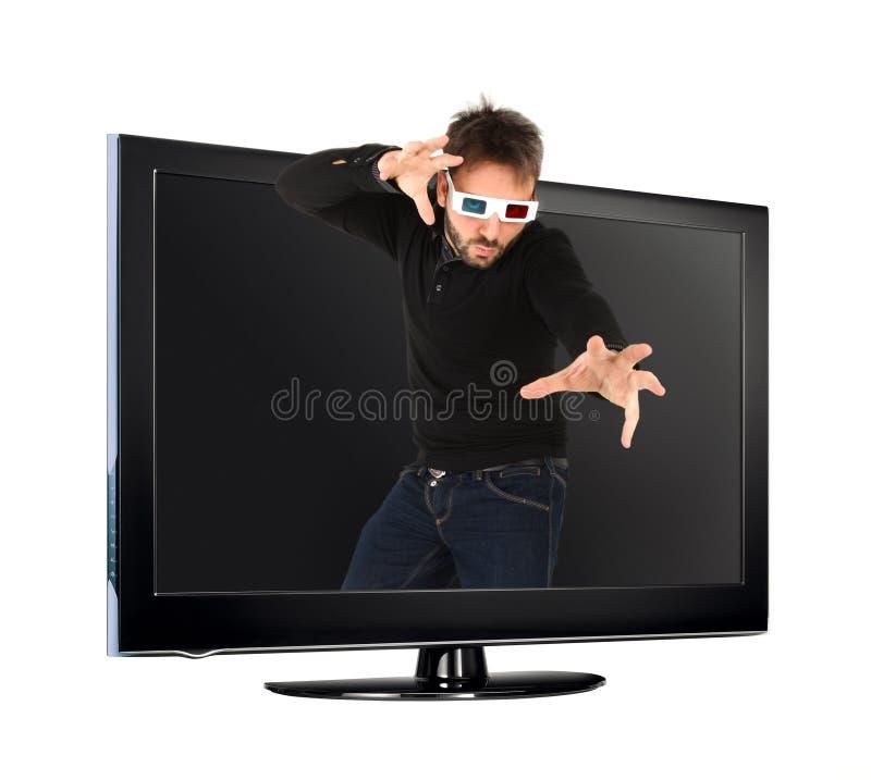 Человек нося стекла 3d из ТВ стоковое изображение rf