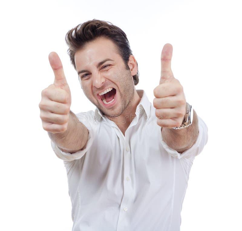 Человек показывая оба большого пальца руки вверх стоковая фотография