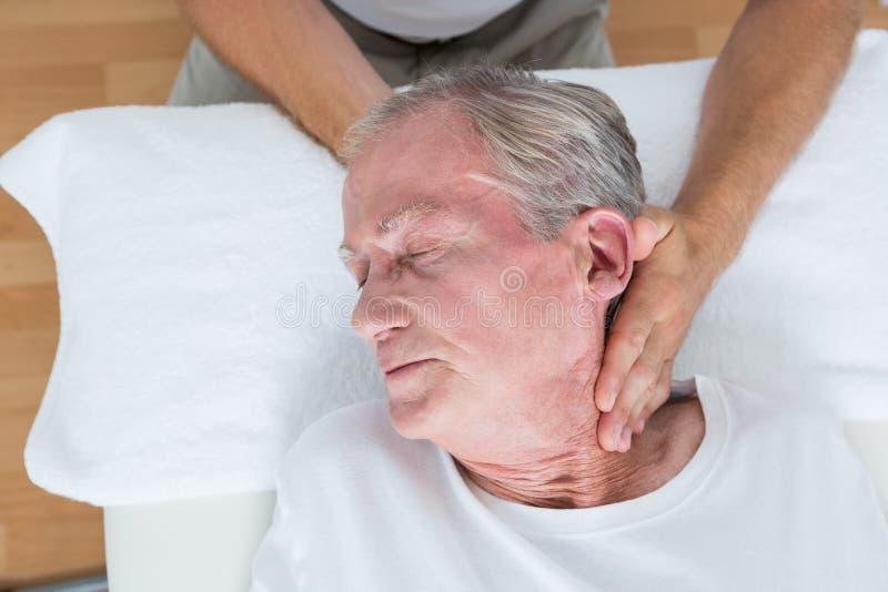 Человек получая массаж шеи стоковое фото rf