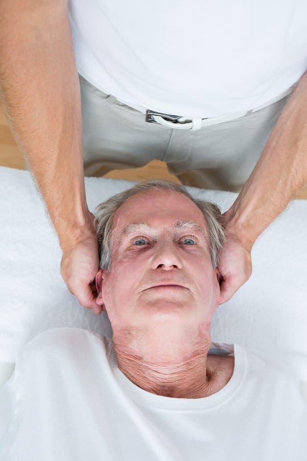 Человек получая массаж шеи стоковые изображения rf