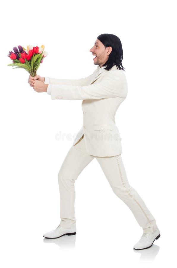 Человек при цветки тюльпана изолированные на белизне стоковые изображения