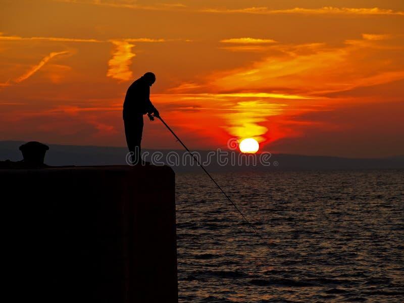 Человек 3 рыбной ловли стоковое фото rf