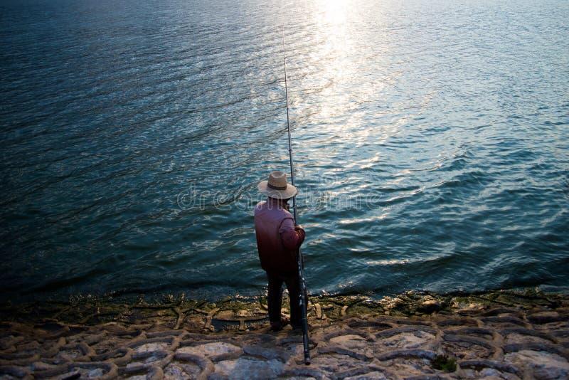Человек рыбной ловли стоковые изображения