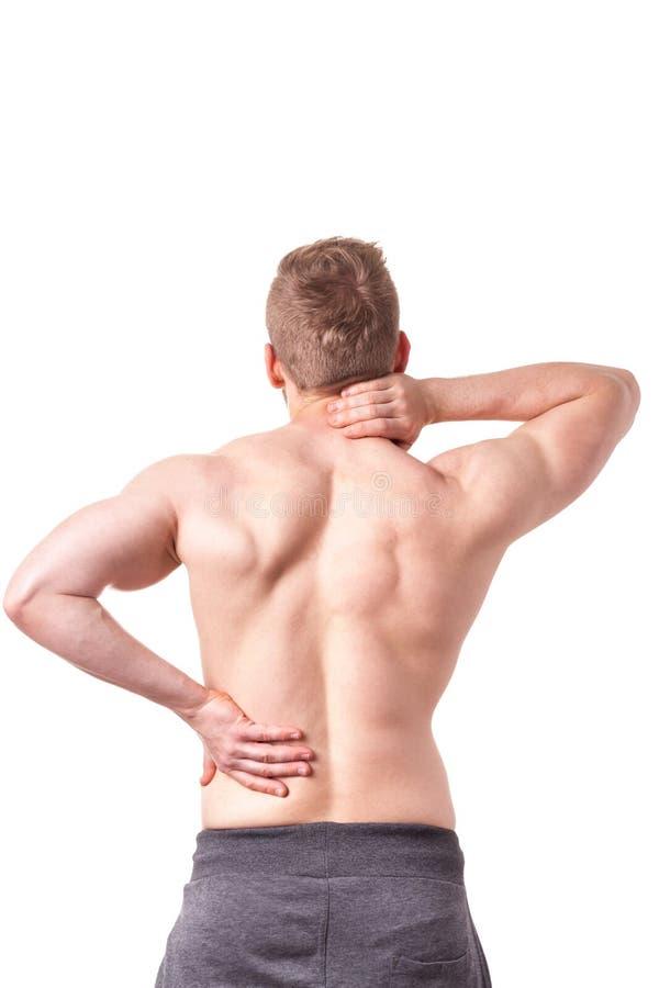 Человек страдая от боли в спине стоковое фото rf
