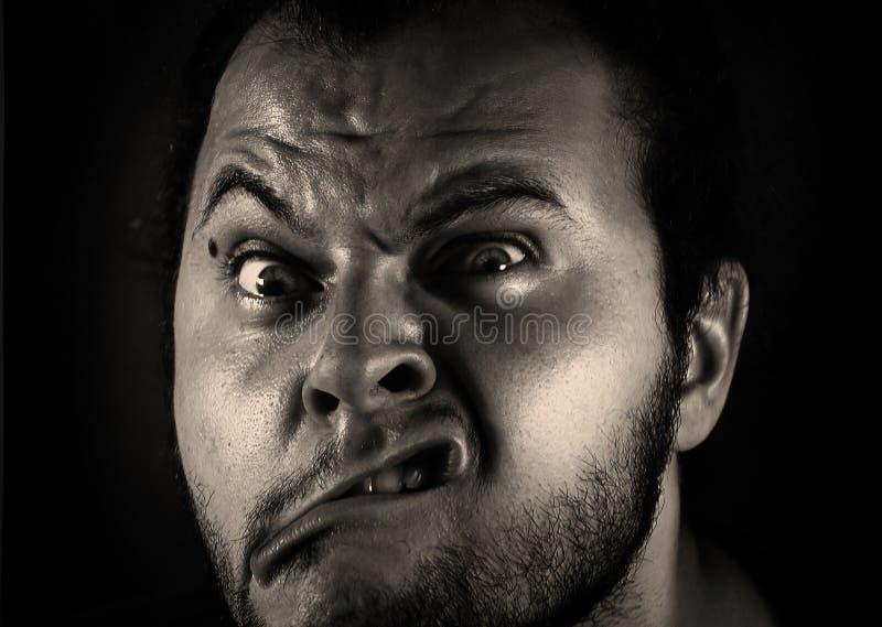 Человек с гримасой стоковое фото rf