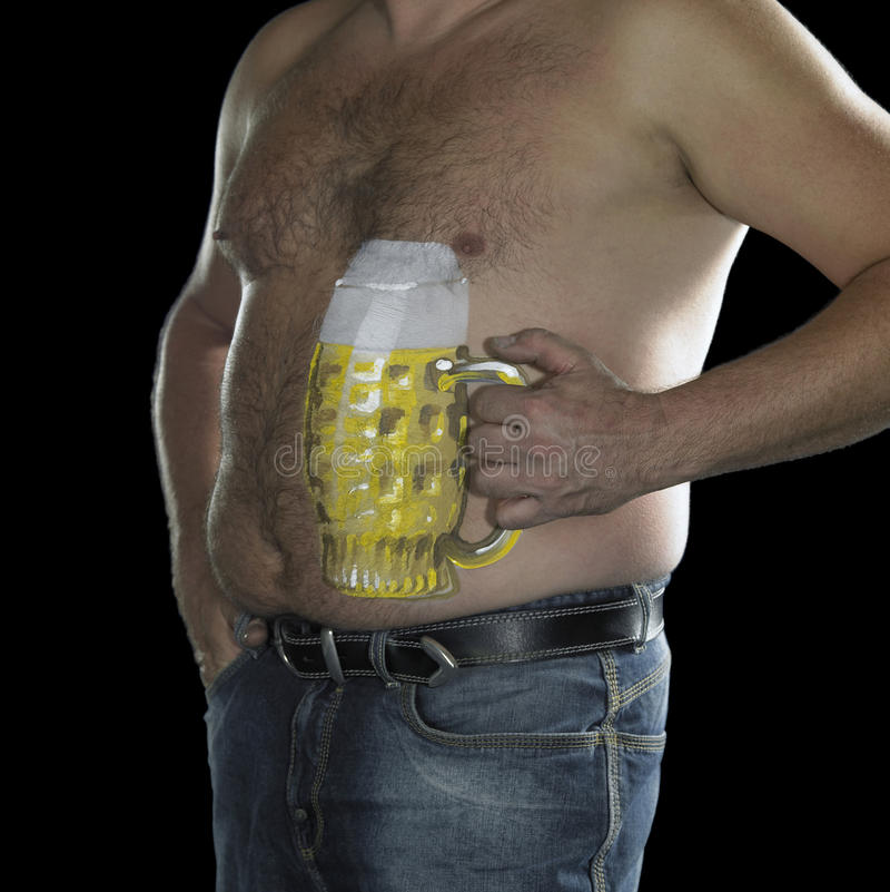 Человек с животом пива стоковое фото rf