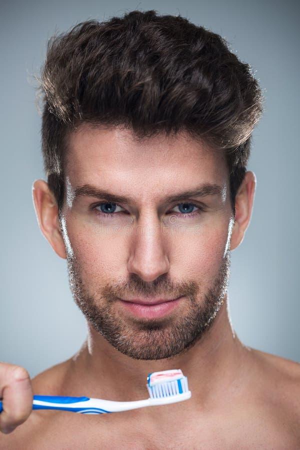 Человек с зубной щеткой стоковые фото