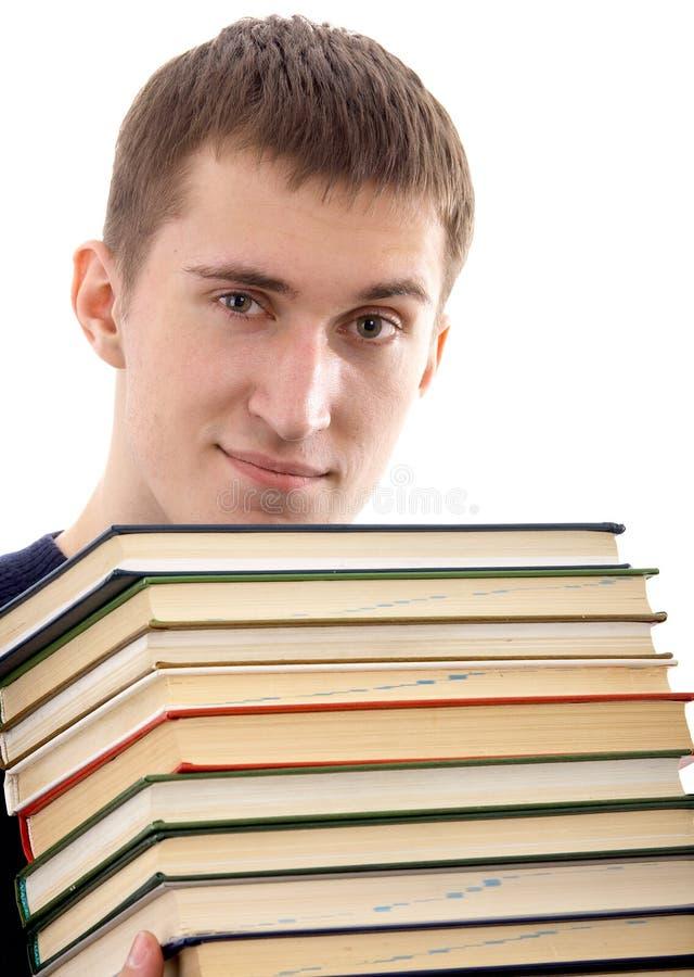 Человек с книгами стоковое изображение