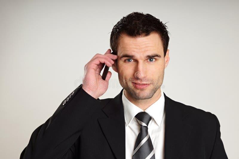 Человек с мобильным телефоном. стоковое фото