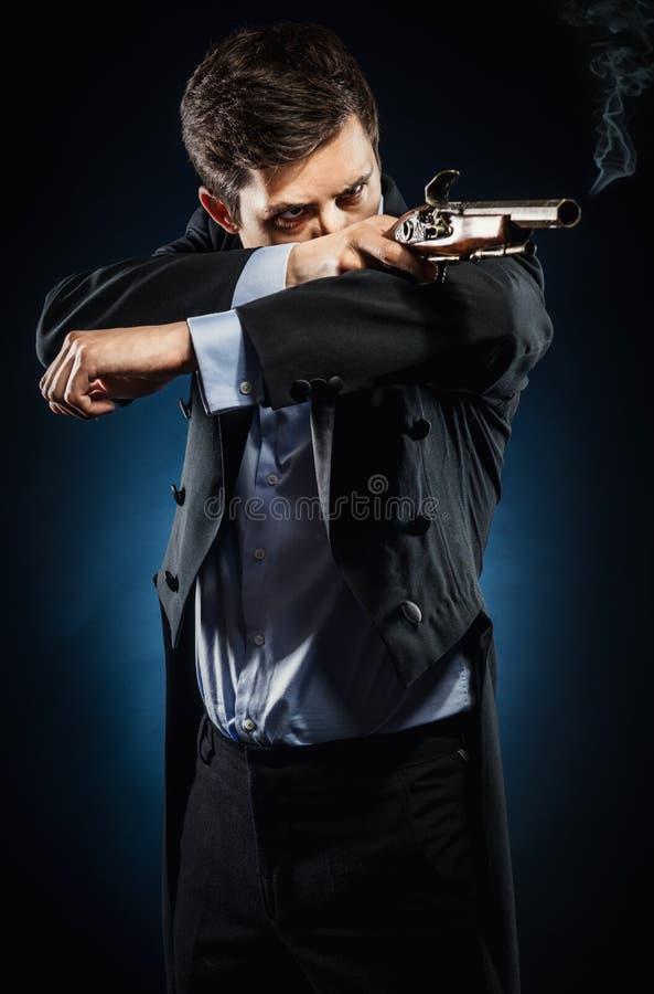 Человек с мушкетом стоковое изображение