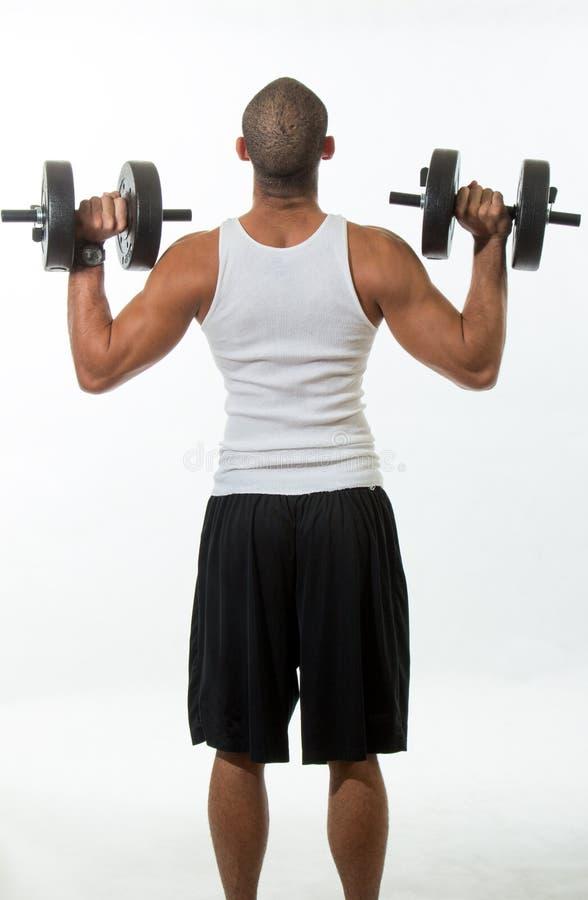 Человек с мышцами стоковые изображения rf