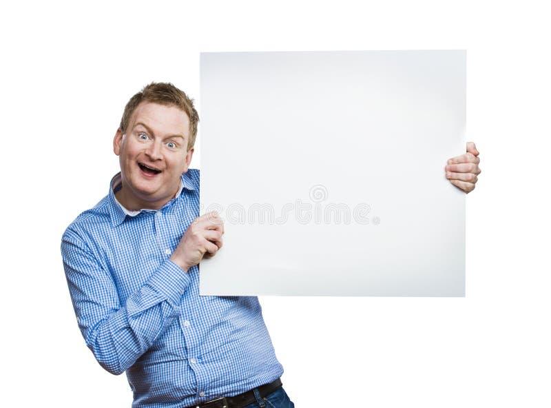 Человек с пустой доской знака стоковое фото rf