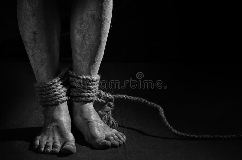 Человек с связанными ногами стоковое фото rf