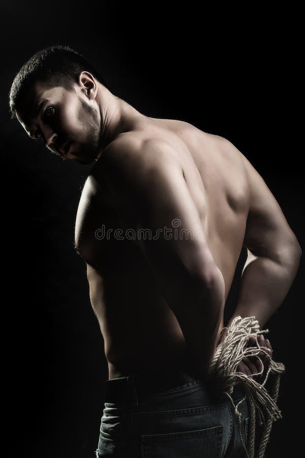 Человек с связанными руками стоковые фотографии rf