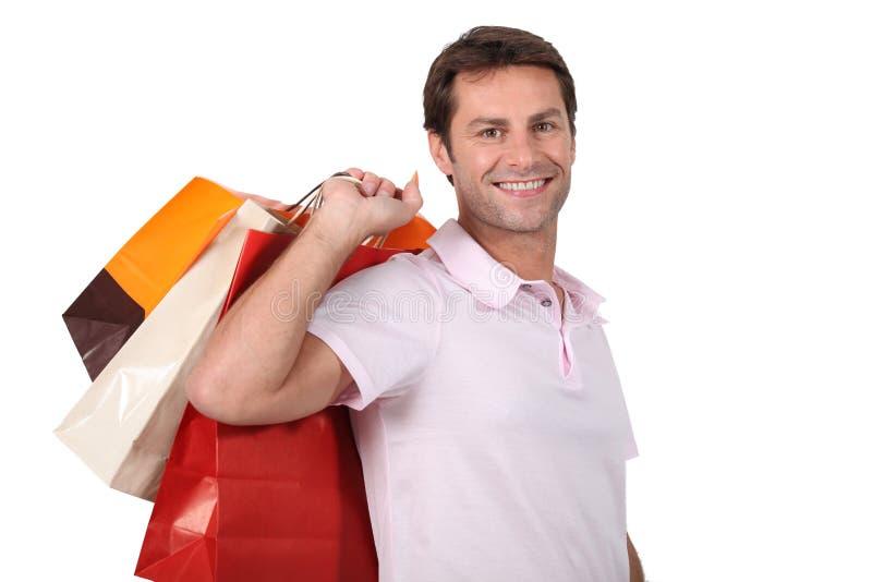 Человек с хозяйственными сумками стоковое фото rf