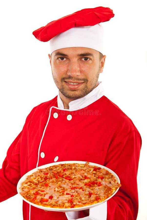 Человек шеф-повара давая вам пиццу стоковые фотографии rf
