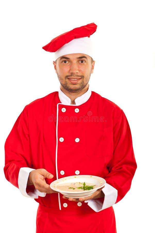 Человек шеф-повара показывая суп стоковая фотография rf