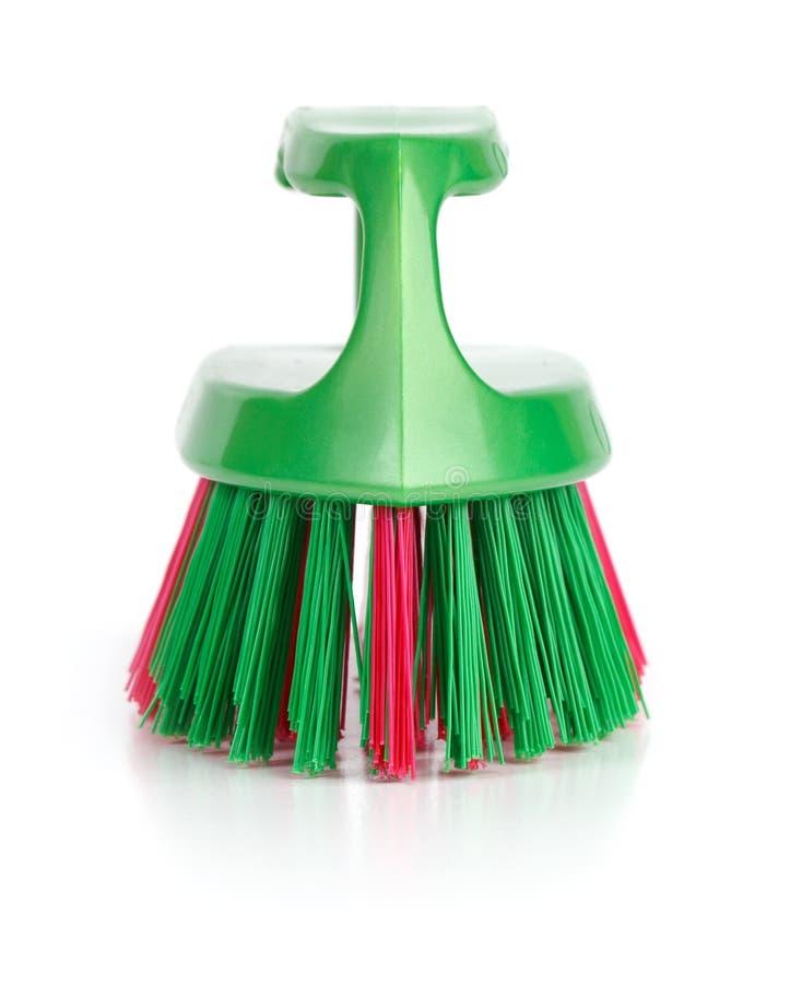 чистка щетки одевает пластмассу стоковое изображение rf