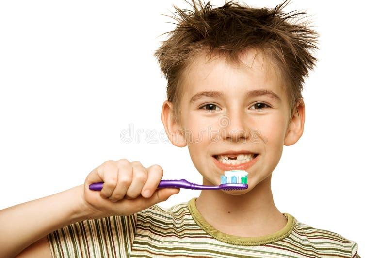 чистя щеткой зубы ребенка стоковая фотография rf