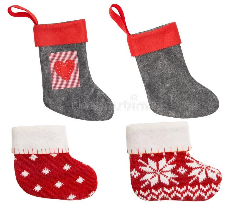Чулок рождества, красная предпосылка носка смертная казнь через повешение изолированная белая стоковая фотография