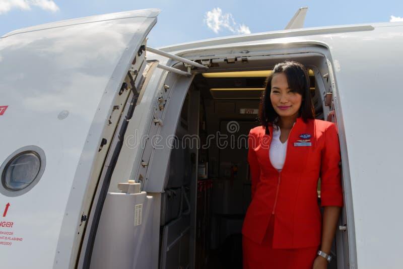 Член команды Air Asia стоковое изображение rf