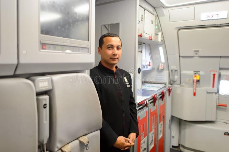 Член команды Air Asia стоковая фотография