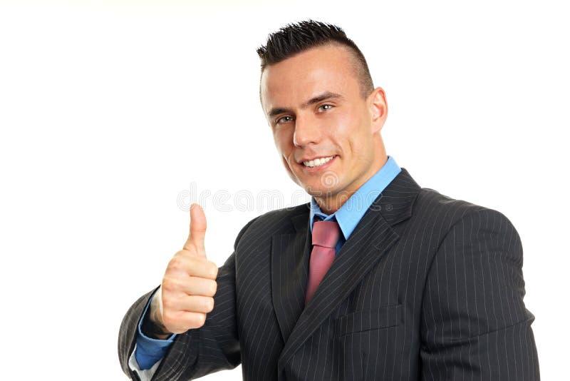 шарж бизнесмена показывая большой пец руки типа вверх стоковое фото