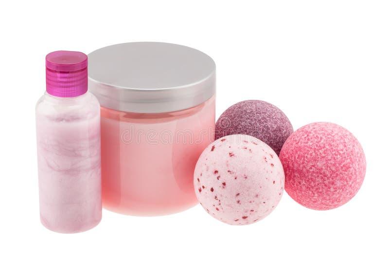 Шарики ванны и косметические бутылки стоковые изображения rf