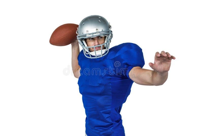 Шарик американского футболиста бросая стоковое фото rf