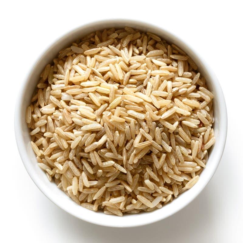 Шар риса длинного зерна коричневого на белизне стоковые изображения rf