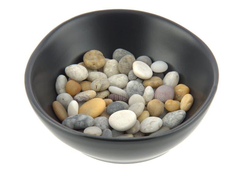 Шар смешанных камешков пляжа в мягком свете стоковая фотография