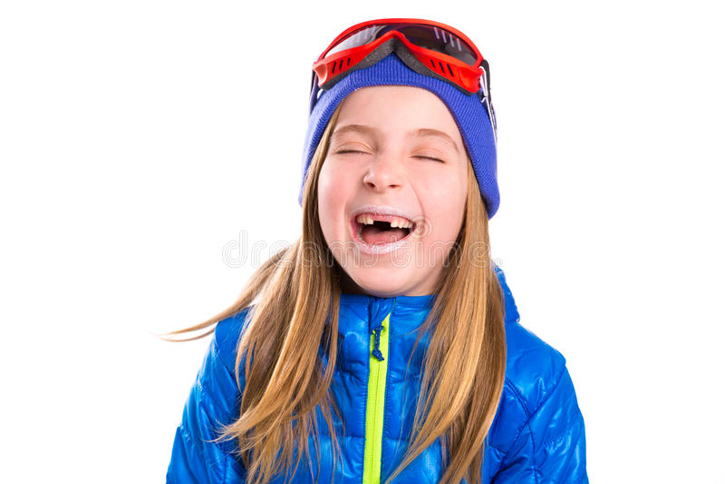 Шальная смеясь над смешная девушка ребенк с шляпой зимы стоковая фотография