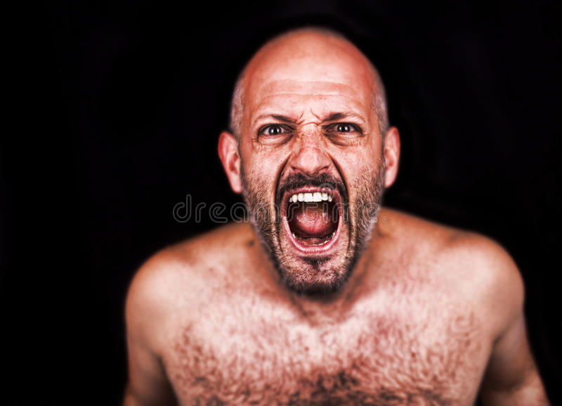 Шальной человек кричащий стоковые фото