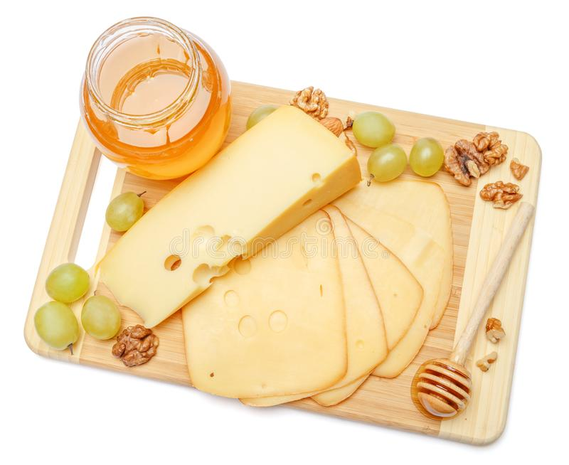 Швейцарский сыр или чеддер и мед на белой предпосылке стоковые изображения