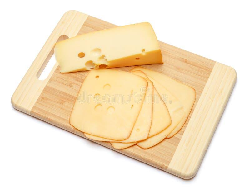 Швейцарский сыр или чеддер и томаты на белой предпосылке стоковая фотография rf