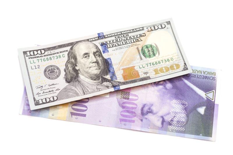 Швейцарский франк и американские доллары стоковое фото rf