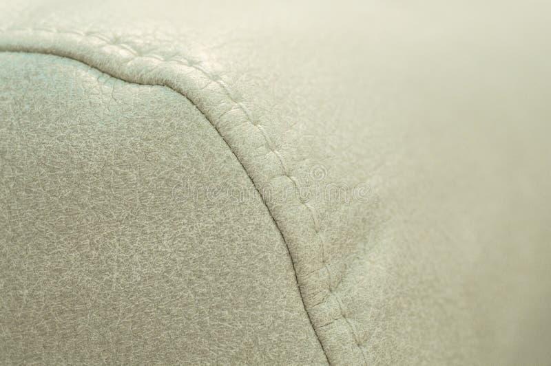 Швы на диване близко Концепция технологии Выставка диванов стоковые изображения