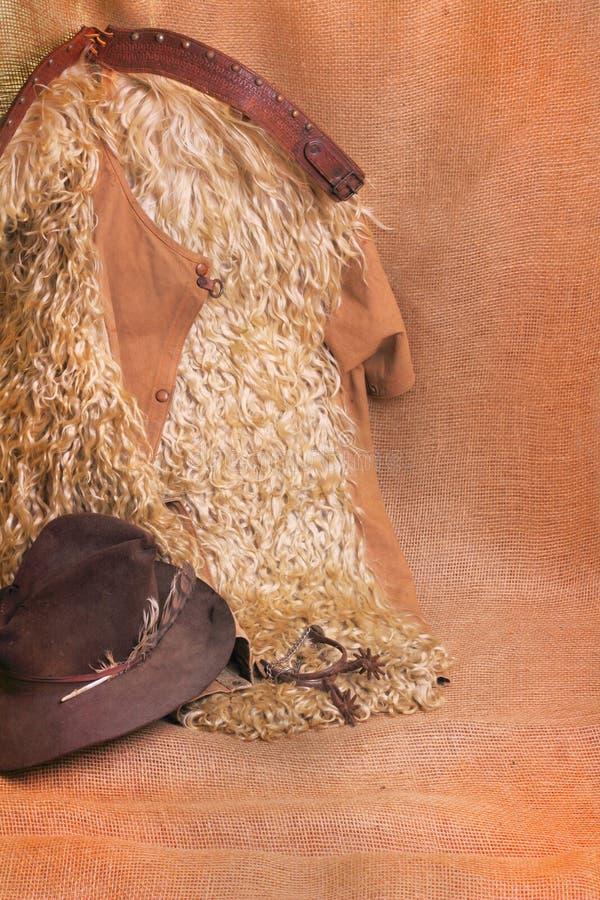 Шерстистые парни, шляпа и шпоры стоковые изображения