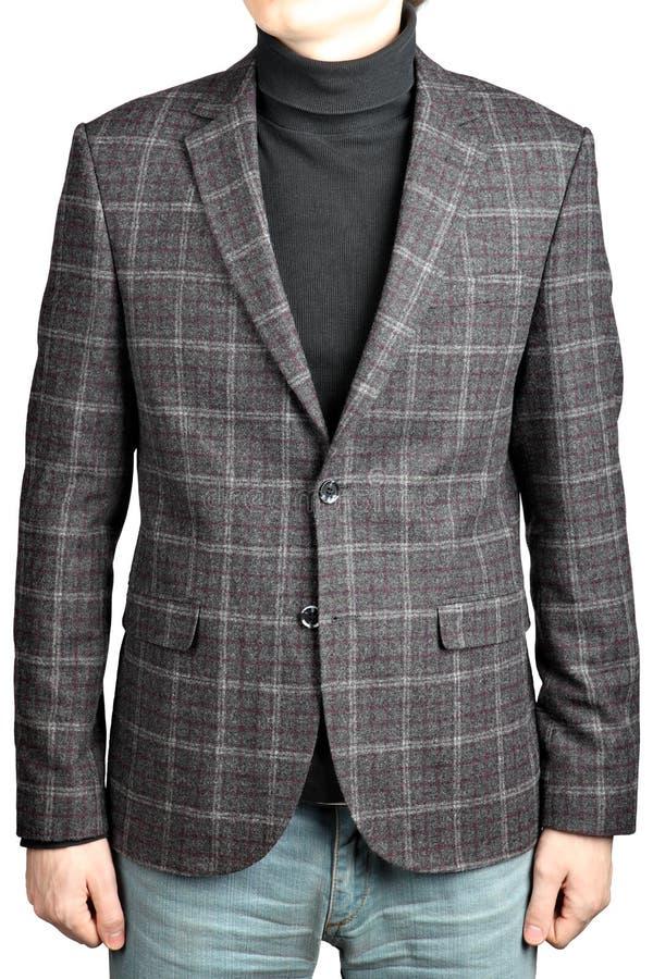 Шерстяная куртка костюма в клетку в комбинации с джинсами стоковое фото