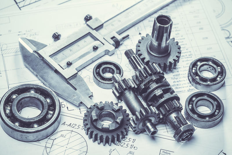 Шестерни металла на технических чертежах стоковое изображение